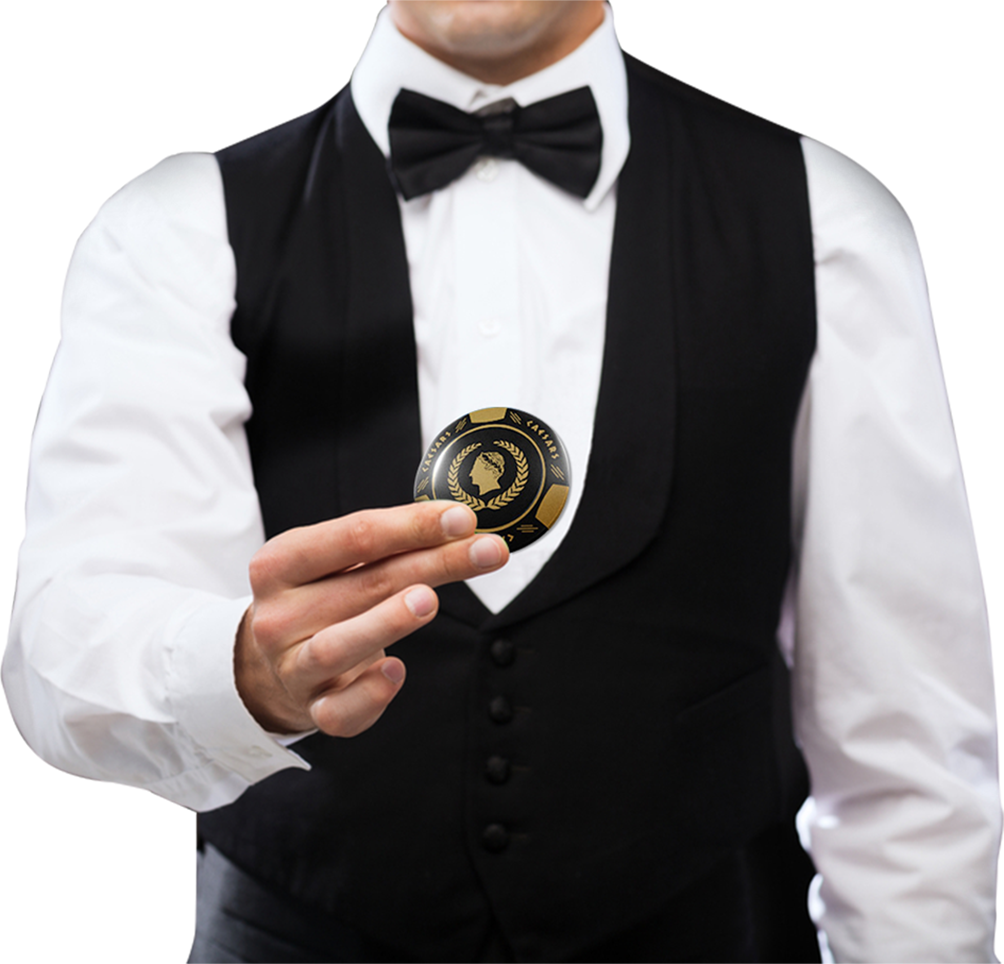 casino dealer holding gambling chip